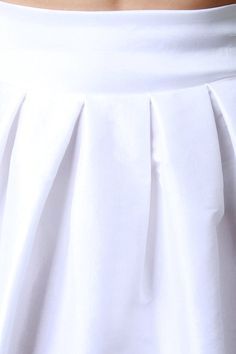 @modaonpoint This flirty skirt features a crisp woven knit fabrication, box pleating design, back bow detail, and finished with a high-low hemline. Accessories sold separately. Made in U.S.A. 60% Polyester, 35% Nylon, 5% Spandex.