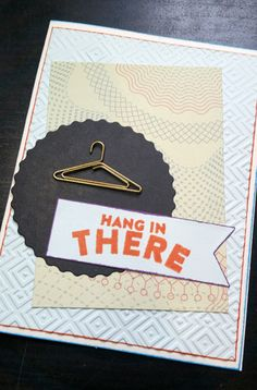"A Bit Of Glue & Paper - handmade greeting card ""Hang In There' stamped sentiment; metal hanger embellishment; die cuts; embossed background panel; orange, light blue"