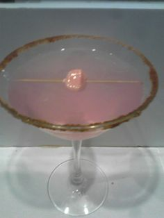 Bubble Gum Martini I made with a bubblegum infusion I made myself. Rimmed with a sweet/spicy chili powder. Garnished with a piece of bubblegum...  For more cocktail pictures, follow the link and like the page.  Thanks https://www.facebook.com/pages/Damien-The-Intoxicologist-Filth/187108378032348?ref=hl  Follow me on instagram. Mixologist_damienfilth  This is my youtube channel.  Check it out.  http://www