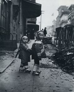 """""""Their First Photograph""""... Two girls holding hands next to construction rubble. From Arnold Genthe's Photographs of San Francisco's Old Chinatown."""