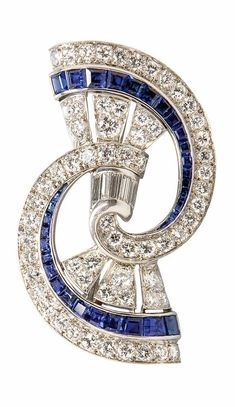 An Art Deco Platinum, Diamond, and Synthetic Sapphire Brooch, set with baguette and old European-cut diamonds, channel-set with synthetic sapphires, lg. 1 in. #ArtDeco