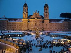 The Einsiedeln Abbey is home to 80 monks. During advent season it serves as background to the largest Christmas market in central Switzerland. ~TravelSmith~