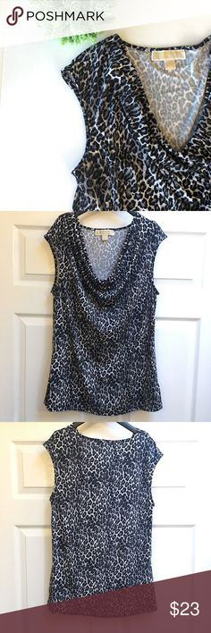 Michael Kors top Animal print draped front sleeveless top. Has a stretch and super comfortable. Size L. 94% polyester and 6% spandex.    🚫 No Trades 💯% Authentic  💵 Offers welcome 💰Bundled discount 📦 Ships in 1-2 days Michael Kors Tops Blouses