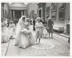 Princess Diana carried flower girl Clementine Hambro through the halls of Buckingham Palace.