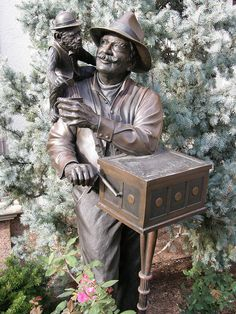 Monkey Business on Country Club Plaza in Kansas City, MO.  Sculpted by Mark Lundeen, this life-size, bronze organ grinder and his pet monkey serve as a reminder of the Italian organ grinder who entertained on The Plaza in years past. Installed in 1990