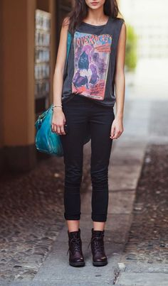 Graphic tees, black skinnies & combat boots.