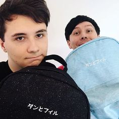 two new backpacks on the dan and phil shop! black glitter nebula or cloud pastel blue, which are you? ☁️✨  danandphilshop.com  us.danandphilshop.com  au.danandphilshop.com