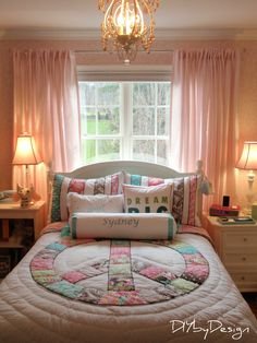 I hate the bedding but like the idea of the the bed in front of window with tables on the side.