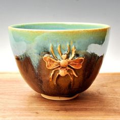merritthyde:    Honey Bee Yunomihttp://www.etsy.com/shop/OneClayBead  The bee is a symbol of happiness and prosperity through one's work.  This Honey Bee Yunomi (tea bowl) comes from the studio of One Clay Bead.
