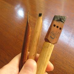 These three different types of pens are sold commercially in Iran. On the left is a reed pen, then a bamboo pen, then a carved wooden pen used for larger compositions.