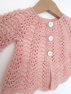 wee Liesl by Ysolda Teague Such a sweet, tiny version of one of Ysolda's popular women's sweater designs. wee Liesl is a top-down cardigan with a beautiful yet simple allover feather and fan lace p… Baby Sweater Knitting Pattern, Knitted Baby Cardigan, Knitted Booties, Knitted Baby Clothes, Baby Knitting Patterns, Baby Patterns, Crochet Patterns, Pullover Hoodie, Crochet Baby Dresses