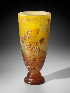 Yellow, red and white, with infusions of gold. Cameo carved portions suggest moslem designs of geometric and floral motifs, containing traces of gold paint. Painted enamel flowers suggest nasturtiums. Lower carved designs suggest clover leaves.