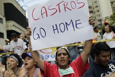 Students in Venezuela protest Castro's communist influence there.