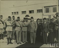 King Farouk visiting the Egyptian army commanders circa 1940s,Ahmed Pasha Hassenein on the right and Hyader Pasha on the left