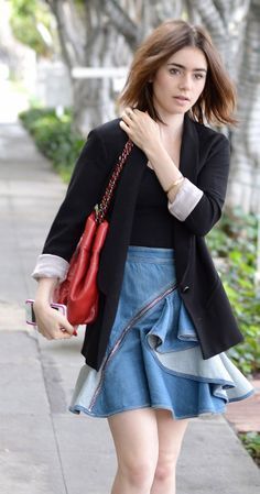 Lily Collins street style | tousled short hair, blazer, tight top unique ruffled denim skirt w/ skin tone flats and red purse