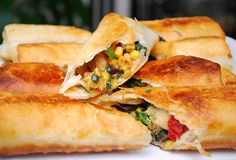 Southwestern Eggrolls... nix the chicken for a vegetarian meal.  black beans, corn, spinach, red peppers, jalapenos, jack cheese... YUM.