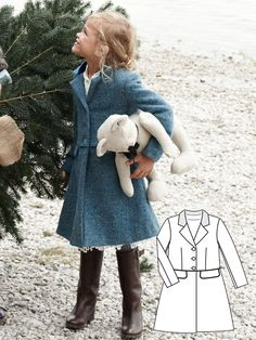 Just as fashionable as mom's coat! This is an adorable, figure-hugging, lined, Dress Coat with waist seam, inseam pockets with flaps, and velvet collar.