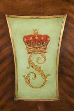 Hand-painted detail on carved mahogany and cerejeira veneered hall chair.