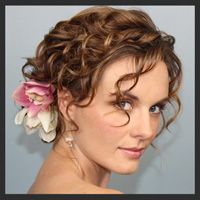 Ohhh, I like this up-do!...especially with the flower!! I think I want all the ladies in my wedding to wear flowers in their hair!