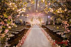 Suhaag Garden, Florida Indian wedding decorator, event design, event decor, Tampa Marriott Waterside Hotel & Marina, modern Mandap, stage, glass mandap, cherry blossom floral archway, wedding aisle, candles, petals