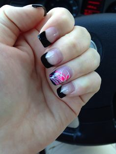 Black tip French manicure with pink accent design.