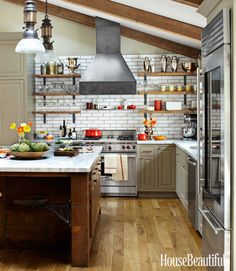 reclaimed wood + open shelving + raw steel + subway tile + marble in rustic chic kitchen design by Dan Doyle via HB
