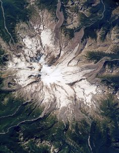 (NASA via Wired Science) Most Beautiful National Parks Seen From Space  Mount Rainier National Park  Location:Washington stateSize:368 square miles  The 14,411-foot Mount Rainier is the highest peak in the Cascade Range and the most topographically prominent mountain in the contiguous United States. This huge stratovolcano is one of 16 volcanoes in the world identified as particularly dangerous, due to its history of large eruptions and its location just 54 miles southeast of Seattle.