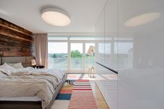Nussberg Penthouse, Vienna :: masterbedroom with a green view