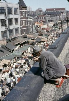 The famous anthropologist, Margaret Meade, photographing Maxwell Street, 1956, Chicago.
