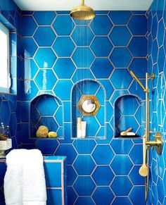 """Shampoo storage never looked so chic. In Justina Blakeney's """"Jungalow,"""" the shower's niche is inset with a vintage mirror. Adriatic Sea hexagonal tiles are by Fireclay Tile. Bad Inspiration, Bathroom Inspiration, Bathroom Ideas, Bathroom Designs, Bathroom Colors, Shower Designs, Bathroom Shelves, Bathroom Remodeling, Colorful Bathroom"""