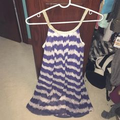 Cute small strap flowy sun dress! Never worn! Brand new. Adorable dress. gold trim for straps and across top Charming Charlie Dresses
