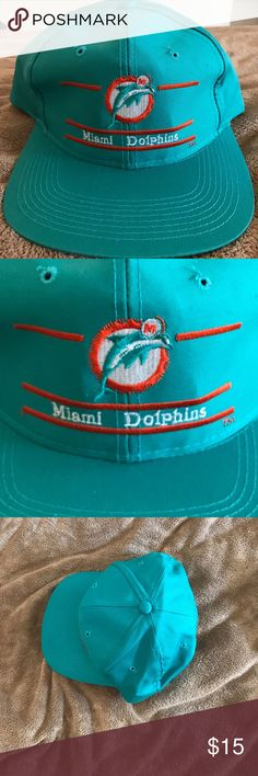 RARE Vintage Miami Dolphins orange&teal SnapBack, RARE Vintage Miami Dolphins orange&teal SnapBack, never worn,embroidered , official NFL GEAR, Pictures provided of condition, Please keep in mind his item is vintagepictures provided of condition. All bundles of 2 or more receive 15% off. Closet full of new, used and vintage Vans, Skate and surf companies, jewelry, phone cases, shoes and more. Accessories Hats