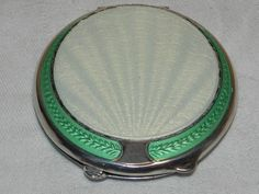 """Mint Green Fully Enamelled Powder Compact by J Gloster of Birmingham. Solid Sterling Silver, it is a beautiful example measuring 2.5"""" inch diameter, all clasps and hinges perfect, opening to reveal a nice clean interior and perfect mirror, fully hallmarked Sterling Silver - assayed in Birmingham 1920"""