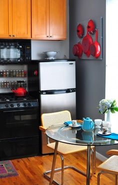 Free up cabinet space with spice rack over stove and a peg board.