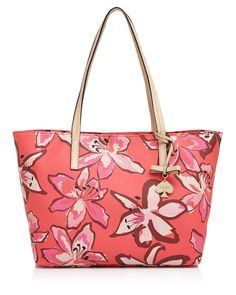 Blooming with a fresh floral print, this roomy faux-leather shopper from kate spade new york takes you from beach to brunch in colorful style. | PVC; trim: leather | Imported | Double handles | Clasp