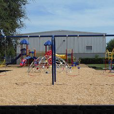 4 bay swing set with various independent play items at Meador Elementary in Houston, TX.
