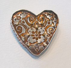 silver heart brooch with 22kt gold