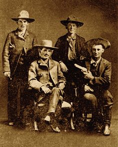 Outlaw Sam Bass (standing at left) worked as a farmhand in Denton, Texas, before turning to horse stealing and robbing stagecoaches. In 1877, he and his gang held up a Union Pacific train in Big Springs, Nebraska, getting away with $60,000.