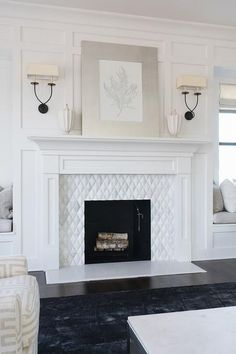Built-in window seats flank a white fireplace mantel accented with white diamond pattern surround tiles and a silver leaf frame placed against a white board and batten wall lit by Visual Comfort Lighting Symmetric Twist 2 Light Sconces. Home Fireplace, Fireplace Tile Surround, Fireplace Design, Family Room, Living Room With Fireplace, Fireplace Remodel, White Fireplace Mantels, Cozy Fireplace, White Fireplace