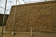 BEAUTIFULLY DETAILED CARVINGS ADORN HIGH ADOBE WALLS OF CHAN CHAN RUINS IN TRUJILLO, PERU