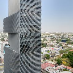 Mexican firm Sordo Madaleno Arquitectos has stacked offset volumes that contain a hotel and office spaces to form a tower in Guadalajara.