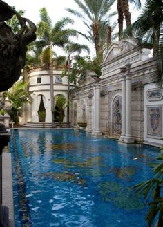 Designer Gianni Versace Celebrity Home _ Gianni Versace's former celebrity home is located in the posh South Beach area of Miami. Its asking price is $125 million. When Versace bought the home in 1992, he invested $33 million in renovations, including adding a new wing, a Swimming Pool, and a garden.