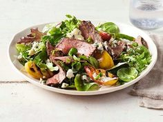 Get Grilled Steak and Peach Salad Recipe from Food Network  Great with pears in winter!