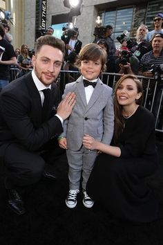 """Aaron Taylor-Johnson, Carson Bolde, and Elizabeth Olsen at the Premiere of """"Warner Bros. Pictures And Legendary Pictures' Godzilla"""" in 2014."""