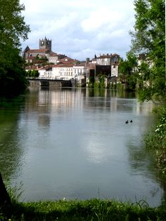 Reflections in the river at Saint Savinien, Charente Maritime, France Images Of France, Saints, River, Mansions, House Styles, Places, Travel, Lugares, Rivers