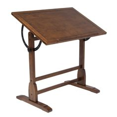 The Drafting Table - Wood is a vintage-style table with a tilting top and wood construction.