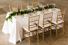 kings table, long wedding table, rectangular table settings, garland runner, value centerpiece, wedding centerpiece by petals edge, michelle lindsey photography