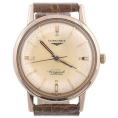 Longines Rose Gold Conquest Automatic Wristwatch | From a unique collection of vintage wrist watches at https://www.1stdibs.com/jewelry/watches/wrist-watches/