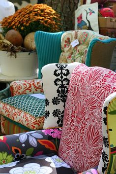 Add some pizzazz and unique appeal to your furniture by mixing and matching interesting upholstery fabrics, as done with these gorgeous wingback chairs.