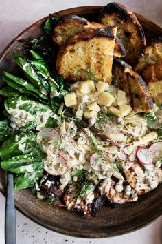 Grilled Chicken Salad with Cornichon Dressing, a backyard summer salad that is so extremely flavorful; full of marinated grilled chicken, charred bread, cheese, radishes, fennel, grilled ramps, and a creamy cornichon dressing - The Original Dish, www.theoriginaldish.com